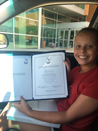 A successful student with her certificate