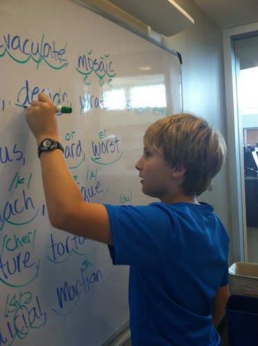 Student working at the whiteboard
